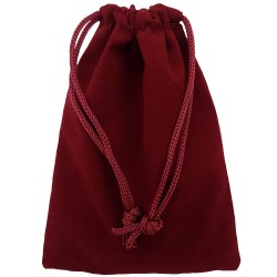 Burgundy colored drawstring velveteen bag shown closed holding a stone rune set.