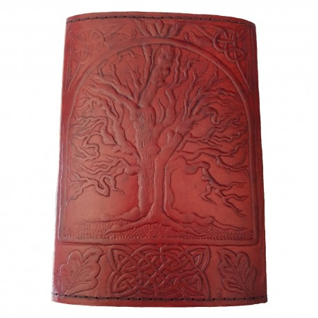 The front cover of the Sacred Oak Tree Leather Journal has an embossed tree and Celtic knotwork design.