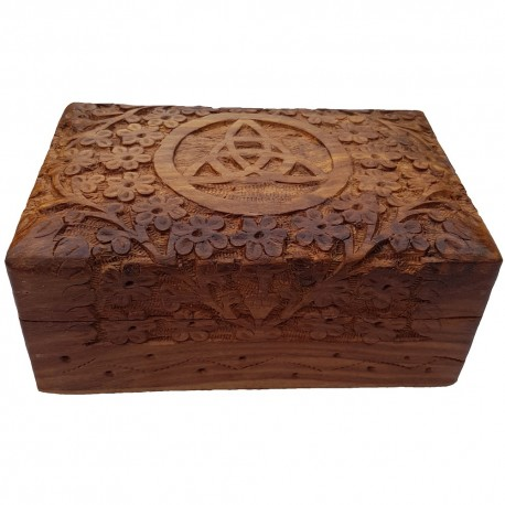 The Floral Triquetra Box is a wooden box with a carved floral pattern surrounding a triquetra.
