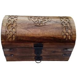 The Celtic cross chest has a rounded lid with a carved image of a Celtic cross and a drawer for storage.